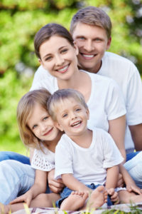 Simon and Gayle a young - middle aged couple with their kids